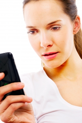Woman using smartphone for AskMD post on Healthin30